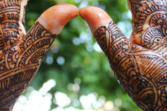 Beautifully mehandi on indian hans for wedding preparation. Beautifully decorated indian hands with mehandi typically done for weddings Stock Photos