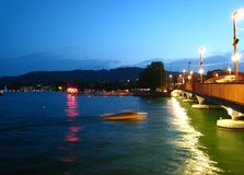 Beautifully night view in summer weather with a speedboat on Lake Zurich royalty free stock photos
