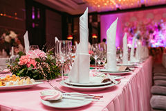 Beautifully organized event, glasses at served festive white table ready. Banquet, wedding decor. Cutlery and crockery. Beautifully organized event, glasses at Stock Photo
