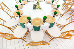 Beautifully organized event - served festive round tables ready for guests. Beautifully organized event - served festive tables ready for guests. gold plates and Royalty Free Stock Photos