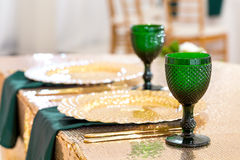 Beautifully organized event - served festive round tables ready for guests. Beautifully organized event - served festive tables ready for guests. gold plates and Stock Photography