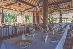 Beautifully organized event - served festive white tables ready royalty free stock images