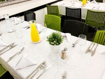 Beautifully organized event - served festive white tables ready for guests. Event in a restaurant. Royalty Free Stock Images