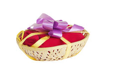 Beautifully packed gift in a basket Royalty Free Stock Photos