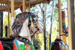 Beautifully painted colorful carousel horses Stock Photos