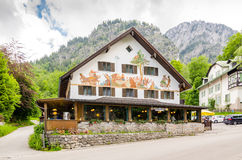 Beautifully painted house in the Bavarian Alps near Neuschwanstein castle in Germany. SCHWANGAU, GERMANY - JUNE 6, 2016: Beautifully painted house in the Stock Photo