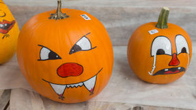 Angry and sad pumpkin at sale on a farm Royalty Free Stock Image