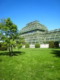 Beautifully palm house in vienna with beautiful garden flowers on a sunny day in springtime royalty free stock photo
