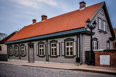 Beautifully renovated old building. Old historic building that is renovated at old town Kuldiga, Latvia. Nice blue skies, no people Royalty Free Stock Photos