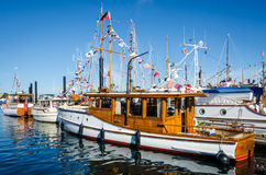 Beautifully restored classic boats. Gather in the Inner Harbour of the provincial capital with the parliament buildings in the background. The 36th Annual Royalty Free Stock Photo