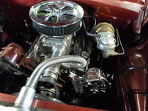 A beautifully restored classic car engine with chrome parts. Stock Photos