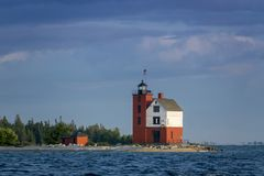 Beautifully painted Historic Round Island Lighthouse Mackinac Island Michigan stock photography