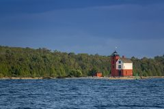 Beautifully painted Historic Round Island Lighthouse Mackinac Island Michigan stock photo