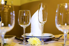 Beautifully served table in a restaurant. Beautiful table appointments for party in the restaurant, focus on glasses in center Stock Photo