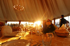 Beautifully served table in a restaurant yellow sunny day wedding glass Stock Images