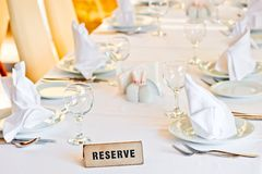 Beautifully set table is reserved for guests of restaurant Royalty Free Stock Photos