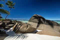 Beautifully shaped granite boulders and a perfect white sand Royalty Free Stock Photography