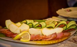 Beautifully sliced apple slices, bacon and cucumber Royalty Free Stock Image