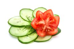 Beautifully sliced tomato and cucumber. Slices of cucumber and a sprig of fresh dill, red tomatoes Stock Photography