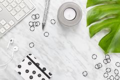 Beautifully styled modern home office workspace. Flat lay composition on marble background, with copy space in the center royalty free stock photo