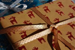 Christmas time! Christmas present with glitter reindeers royalty free stock photos