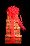 Beautifully wrapped Christmas present. With a red bow isolated on a black background for a dramatic effect Royalty Free Stock Image