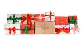 Beautifully wrapped gift boxes. On white background Stock Photos