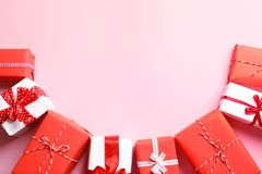 Beautifully wrapped gift boxes on color background. Top view royalty free stock photo