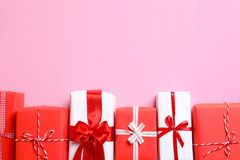 Beautifully wrapped gift boxes. On color background, top view royalty free stock images