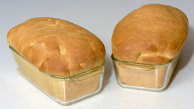 Beautifuly baken bread loafs with golden tops Royalty Free Stock Photos