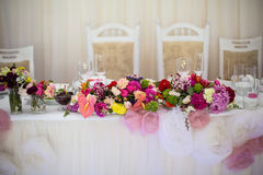 Beautifuly decorated wedding reception table covered with fresh Royalty Free Stock Image