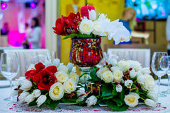 Beautifuly decorated wedding reception table covered with fresh flowers stock images