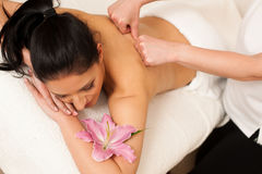 Beautifulyoung woman having a rejuvenating massage in a wellness. Studio - spa stock image