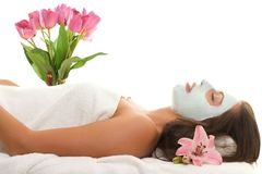 Beautifying Treatment. A relaxed young woman with a treatment facial Stock Photos