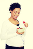 Beautifyl young woman eating strawberries Royalty Free Stock Photo