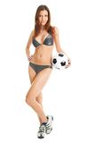 Beautilful woman in bikini posing with soccer ball Stock Photos