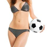 Beautilful woman in bikini posing with soccer ball Royalty Free Stock Photography