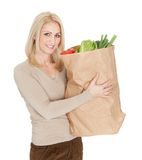 Beautilful woman with grocery bag Stock Photography