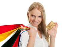 Beautilful young woman carrying shopping bags Royalty Free Stock Images