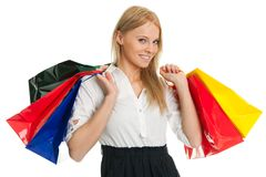 Beautilful young woman carrying shopping bags Stock Photography