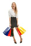Beautilful young woman carrying shopping bags Stock Photos