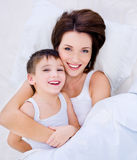 Beautioful laughing mother and pretty son Royalty Free Stock Images
