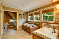 Beautirul bathroom with windows Royalty Free Stock Image