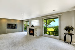 Beautitful living room with fireplace and walkout deck Royalty Free Stock Image