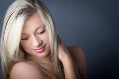 Beautitul Blond Model looking down , Smiling Royalty Free Stock Images