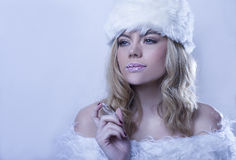 Beautitul woman in white winter fur Royalty Free Stock Photography