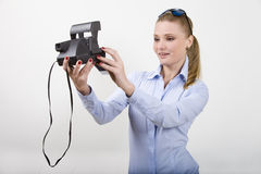 Beautitul young woman holding  photocamera Stock Photography