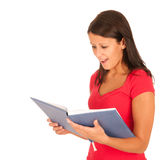 Beautiul brunette reading a book Royalty Free Stock Images