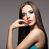 Beautiul elegant woman with turquoise make-up and long hairs Royalty Free Stock Photo