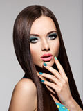 Beautiul elegant woman with turquoise make-up and nails. Straigh Royalty Free Stock Photo